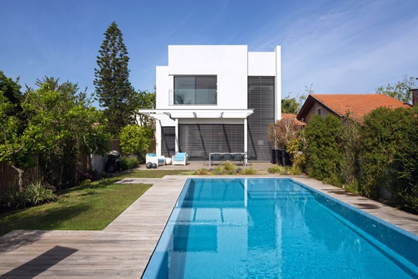 Backyard of the contemporary house in white