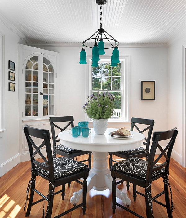 Beach style dining room with captivating pops of turquoise