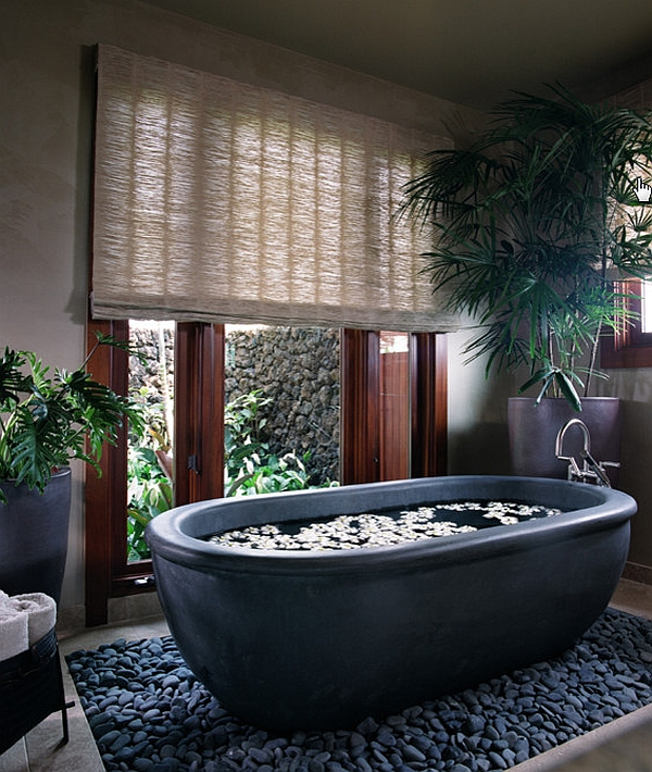 Beautiful basalt tub placed in a bed or river rocks