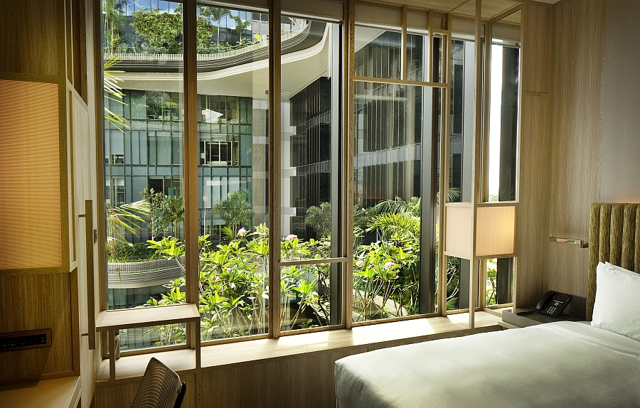 Bedroom at the PARKROYAL on Pickering with a view of green balconies