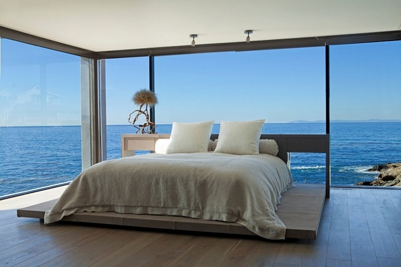 bedroom with ocean views and glass walls decoist