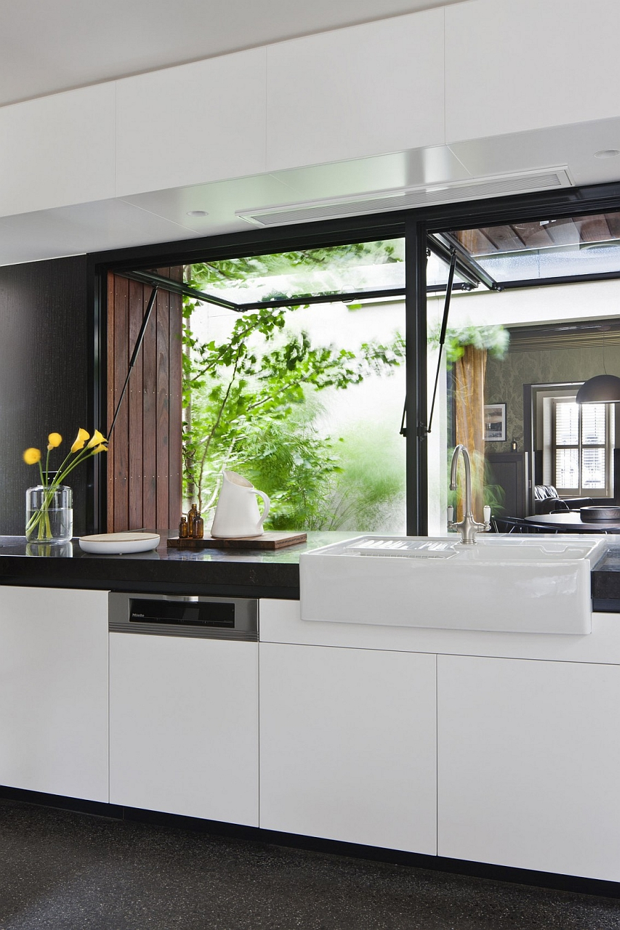 Black kitchen countertop with a white sink