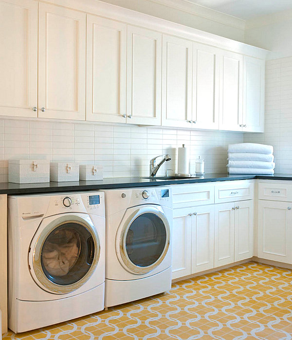 Cabinet storage in a laundry room with a tile floor