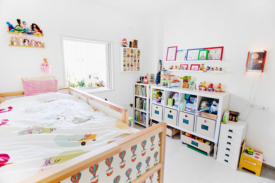 Colorful kids' bedroom with loads of toys
