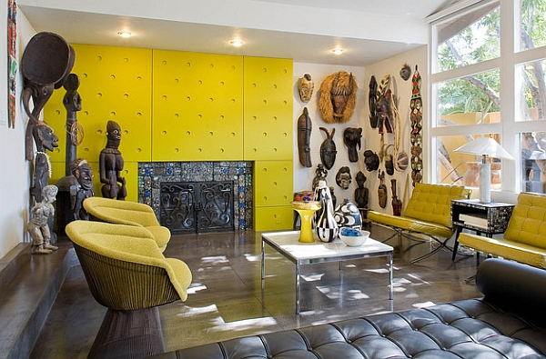 Colorful living room displays a wonderful collection of African statues and artifacts