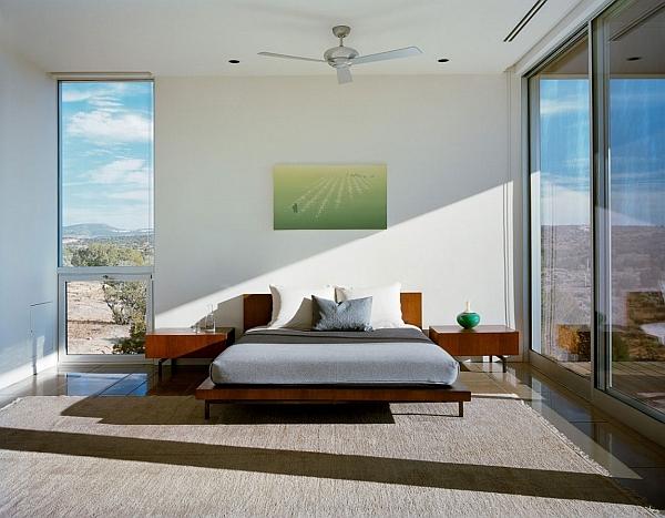 Contemporary bedroom inside steel-framed prefab home