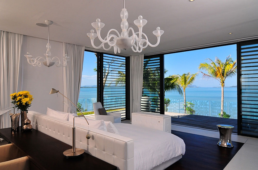 Contemporary bedroom with sweeping sea views