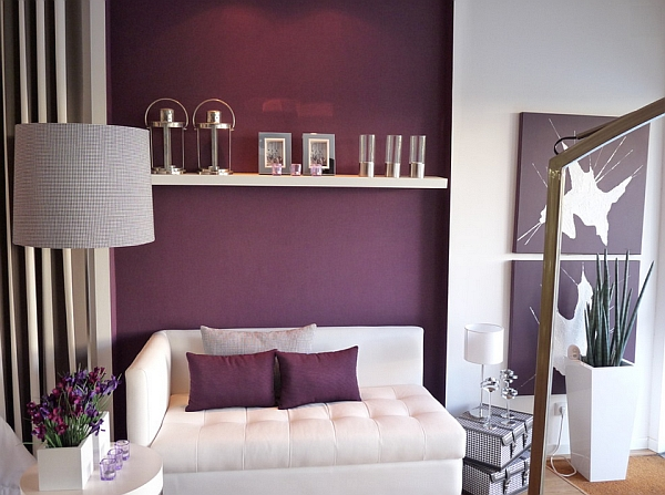 Contemporary living room with a purple accent wall