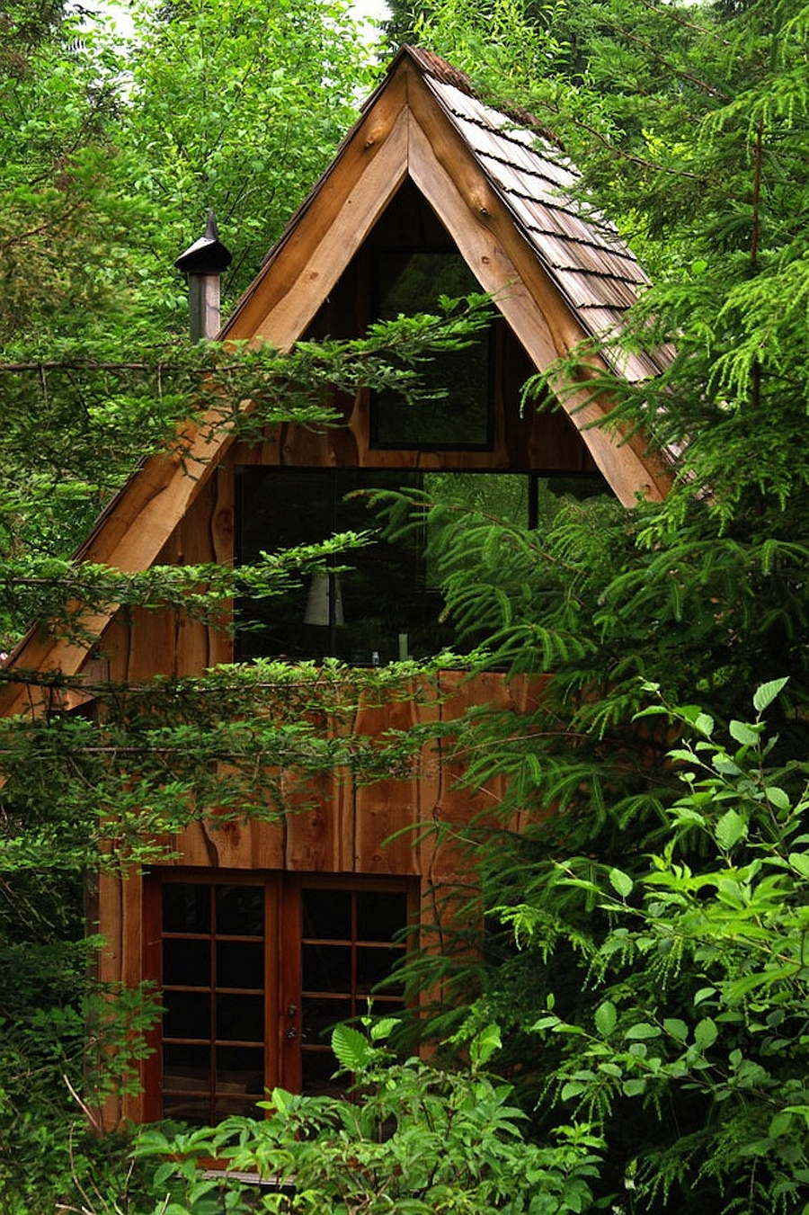 This amazing forest house was built for just 11 000 with for Wood cabin homes
