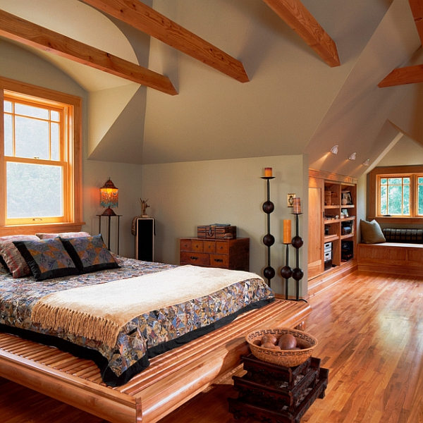 Cozy attic bedroom idea with a window seat