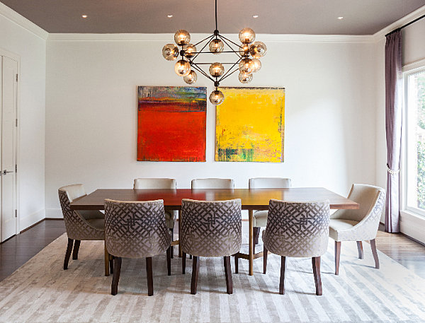 Dining room with yellow and red artwork The Relationship Between Interior Design, Color and Mood
