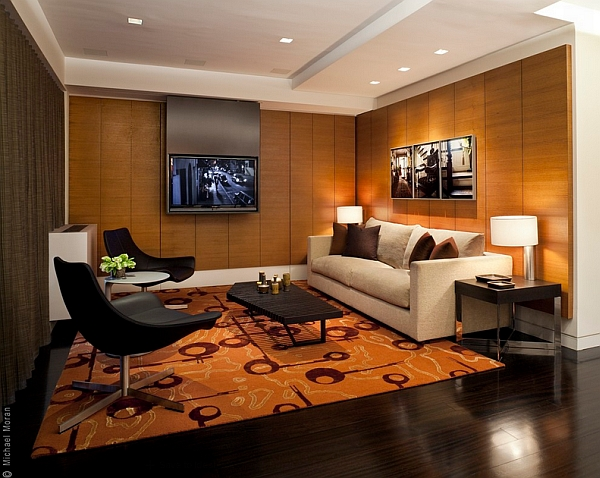 Elegant rug and wood paneling give the room inviting warmth
