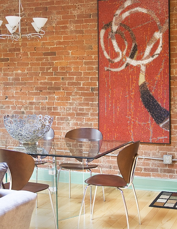 Exposed brick wall adds an eclectic element to the space