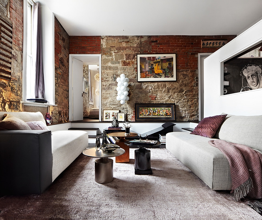 Exposed brick wall in the living room gives an eclectic look