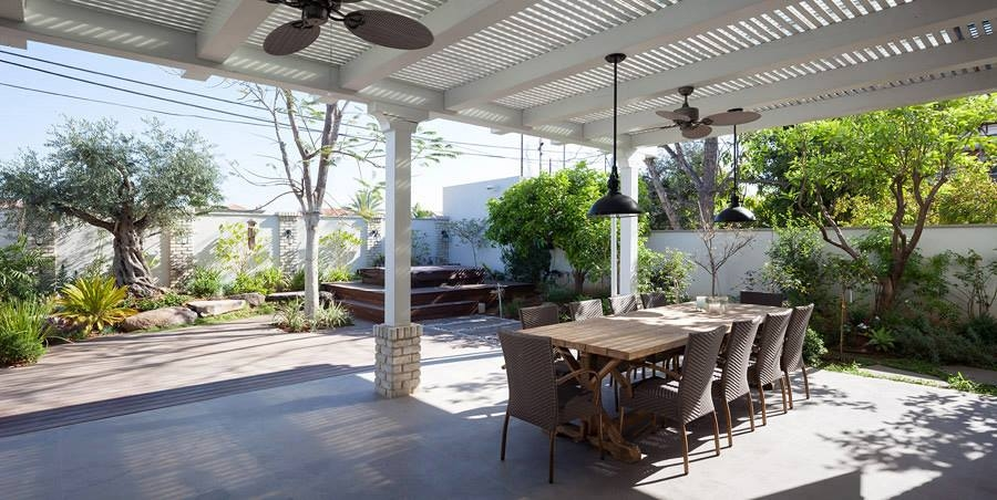 Extended pergola offers shade to the patio