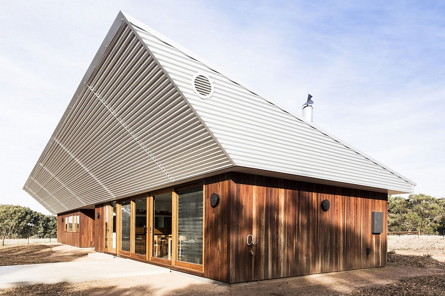 Energy-Efficient Home Charms With A Distinct Roof And An ...