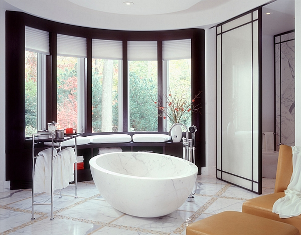 Freestanding marble bathtub in an Asian themed bathroom
