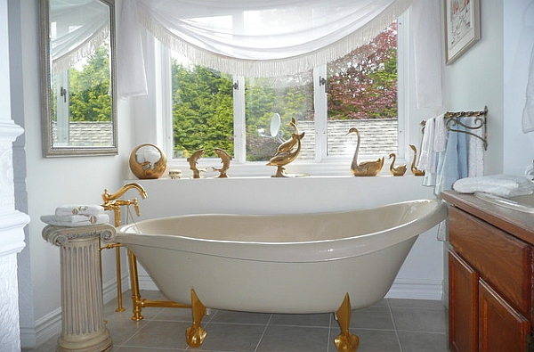 French flair and golden accents define this lavish bath space