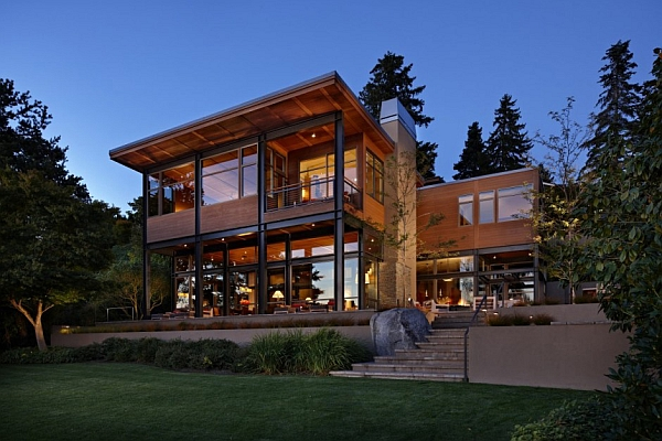 Glass lake house with bold steel frame