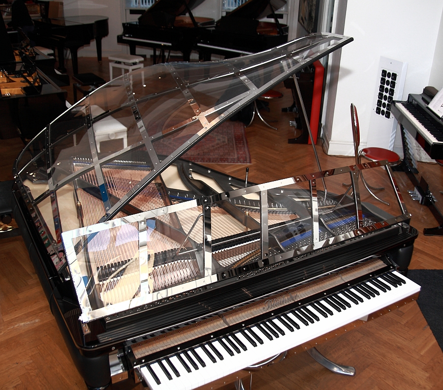 Goregous Piano in silver plate and black leather