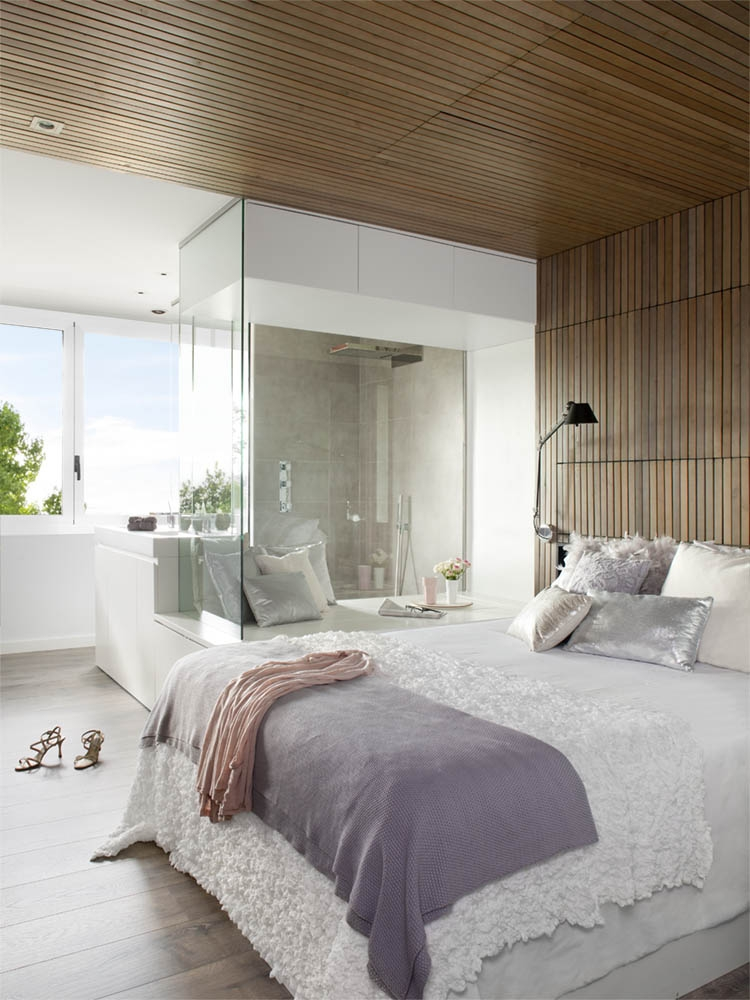 Gorgeous bedroom in white with wooden backdrop