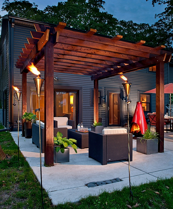 Gorgeous torches create a truly spellbinding pergola setting Outdoor Inspiration: Cool Tiki Torches To Light Up Your Magical Evenings