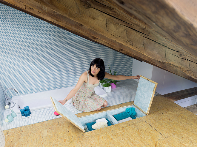 Hidden compartment in the floor next to the bathtub