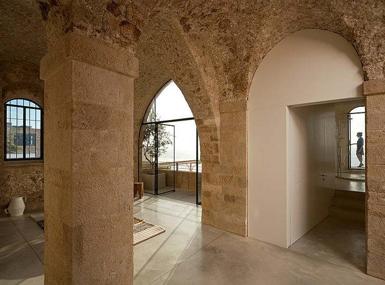 High ceiling and arched doorways in stone of modern house