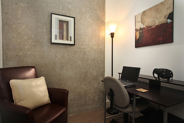 Home work area with exposed concrete wall