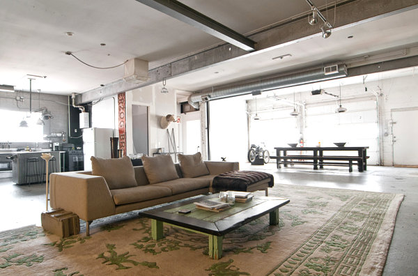 Industrial living room with an exposed ceiling