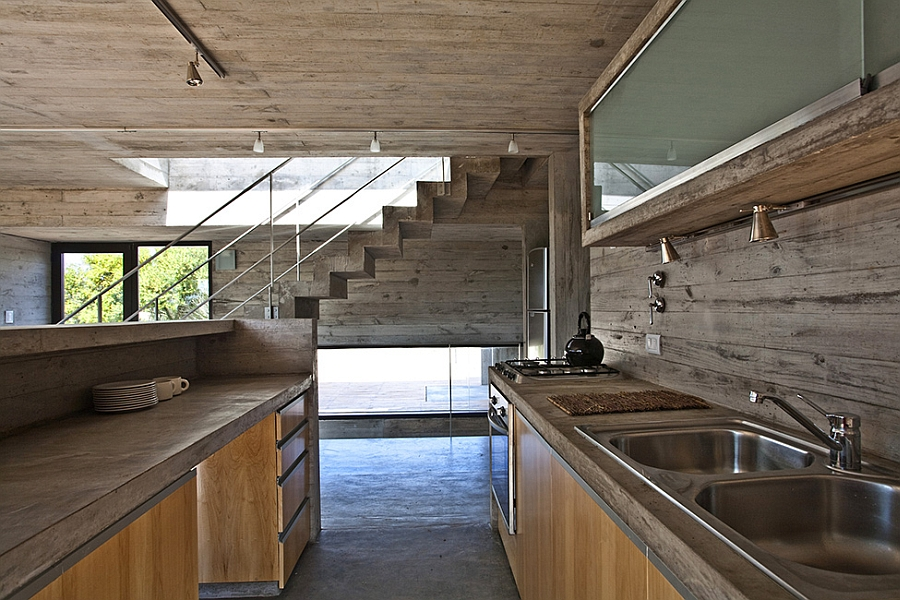 Modern house ushers in industrial style with raw concrete for Industrial modern kitchen designs