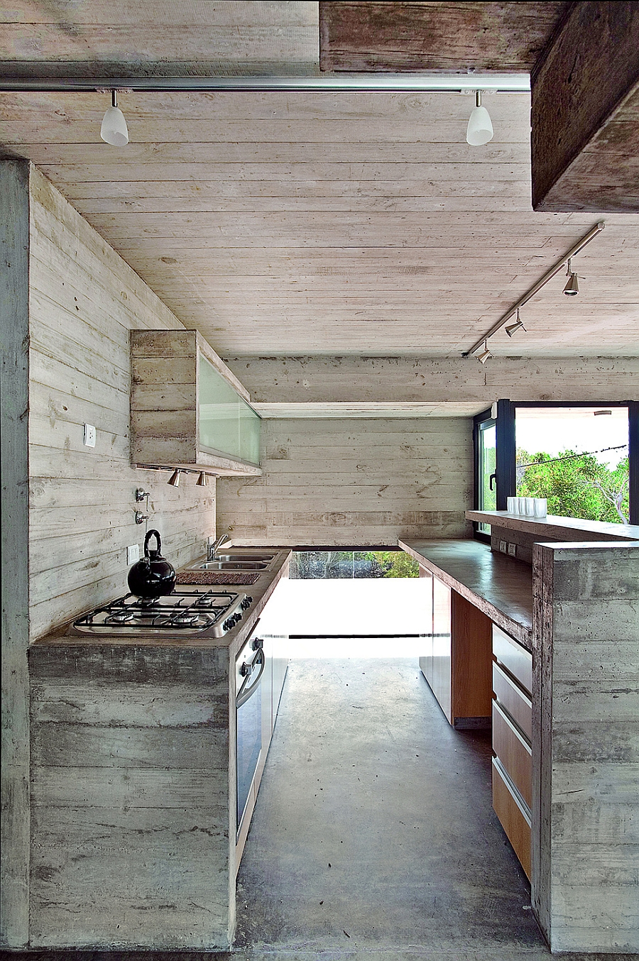 Kitchen with exposed concrete and wood