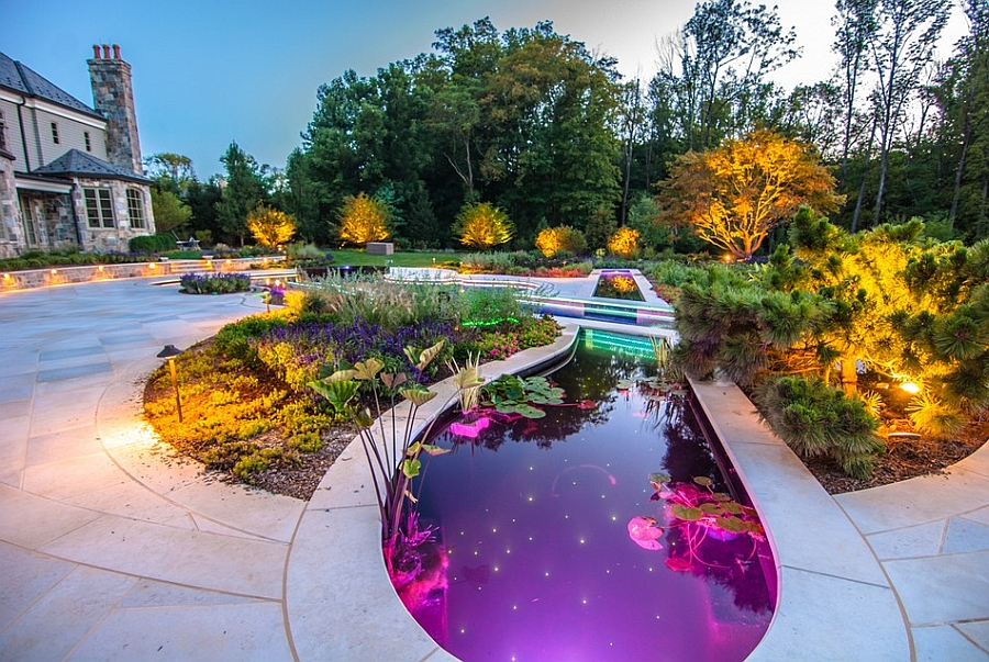 Koi pond next to the pool with LED lighting