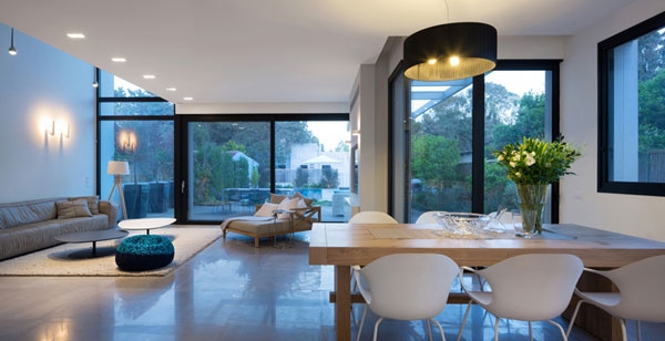 Large black drum pendants and wooden dining table