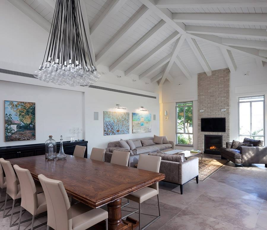 Large dining area with adjacent family room Elegant Modern Villa In Israel Embraces A Relaxed Country House Vibe