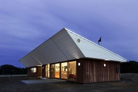 Energy-Efficient Home Charms With A Distinct Roof And An Earthy Ambience