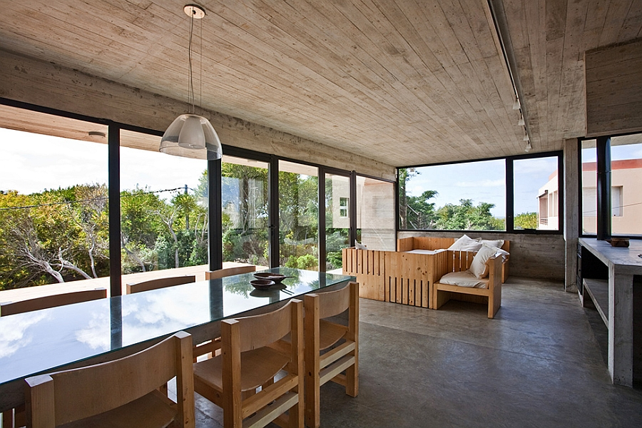 Living area surrounded by glass windows