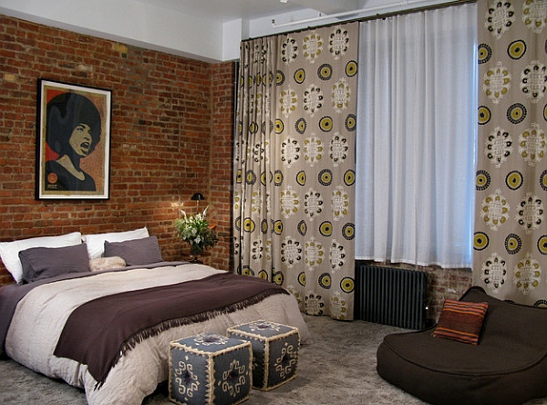 Loft apartment bedroom blends the eclectic with the African