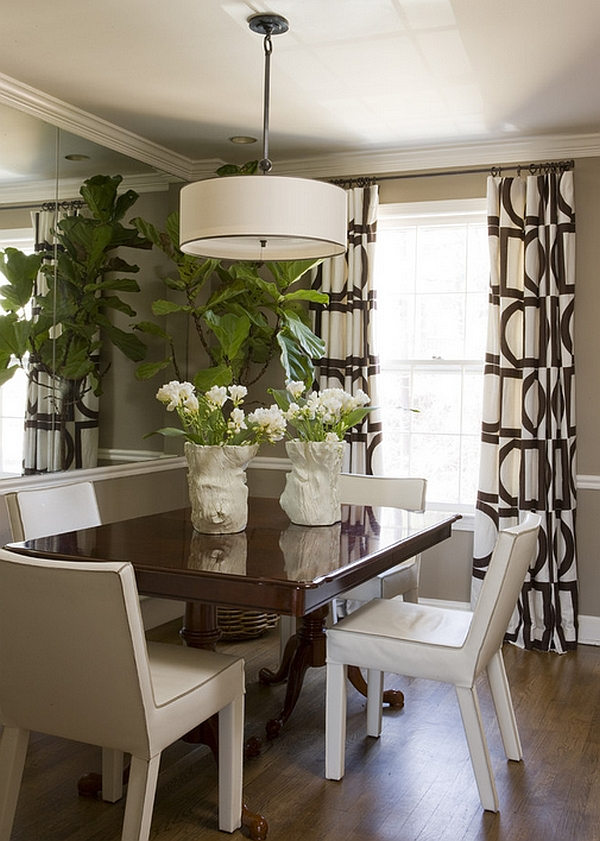 Lovely drapes and large pendant add style to the small space