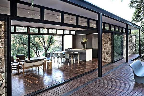 Lovely steel frame and glass pavillion creates an airy setting