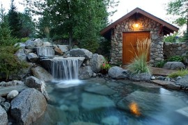 Magical outdoor space with a pool waterfall