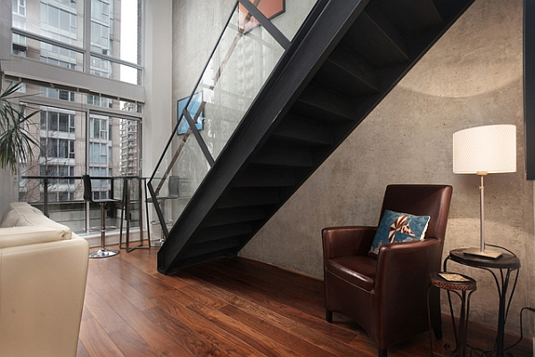 Metal staircase with glass railing in a contemporary loft