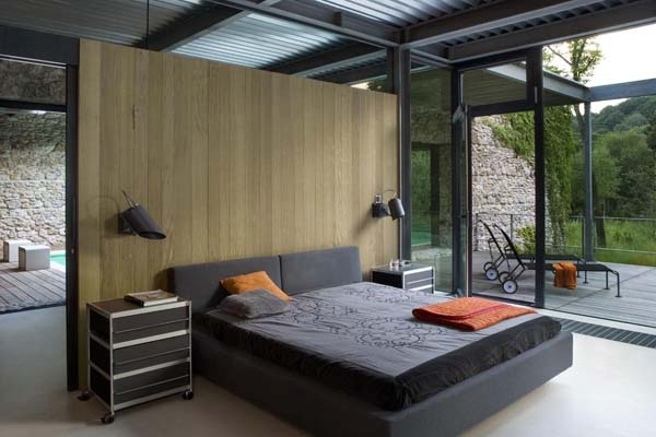 Minimalist bedroom in grey with glass walls