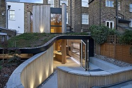 Modern Victorian House modern revamp involving a glass roof transforms this dark