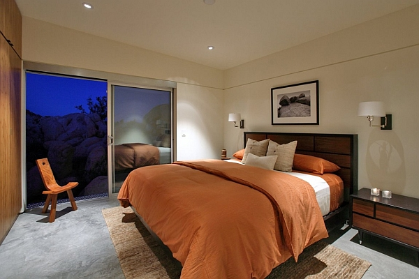 Modern bedroom with tangy orange accents