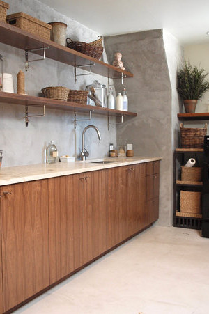 Modern laundry room with earthy accents