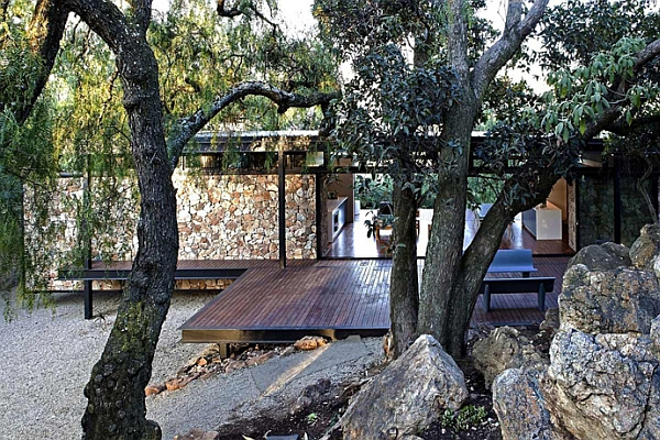 Natural canopy offers shade to the steel-framed home