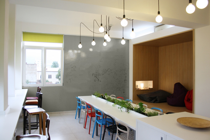 An office design that promises to beat your monday blues for Office lunch room design ideas