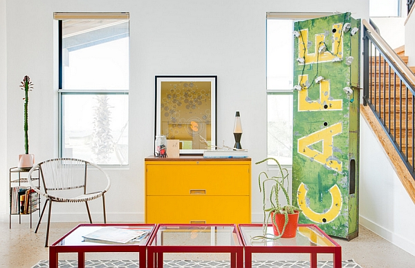Over-sized vintage cafe sign and a lava lamp in the living room