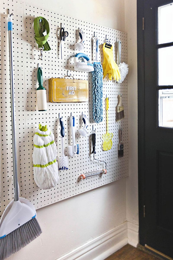 Pegboard wall of cleaning supplies
